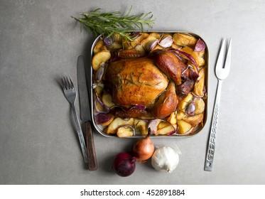 Roast Chicken on stone background