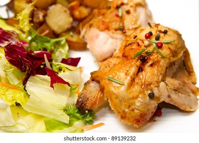 Roast chicken with salad and potatoes