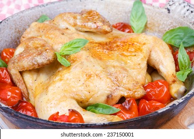 Roast chicken with tomatoes cherry, green basil and garlic