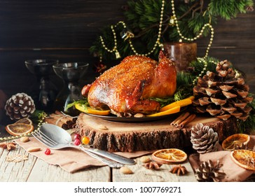 Roast chicken or turkey for Christmas Dinner and New Year with mulled wine and Christmas decorations, space for text, selective focus