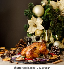 Roast chicken or turkey for Christmas and New Year with mulled wine and Christmas decorations, space for text, selective focus