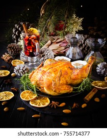 Roast chicken or turkey for Christmas and New Year Thanksgiving Day with mulled wine and Christmas decorations, selective focus