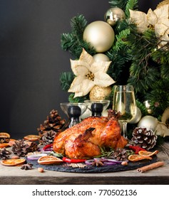 Roast chicken or turkey for Christmas and New Year Thanksgiving Day with mulled wine and Christmas decorations, space for text, selective focus