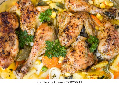 Roast chicken with vegetables and herbs baked in the oven. View from above.