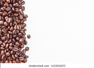 Roast coffee beans on white background.