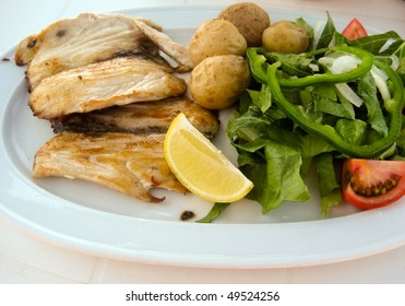 roast cutlet of pork with boiled potatoes and salad