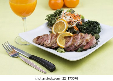 Roast Duck Breast with Orange sauce and Vegetable/selective focus