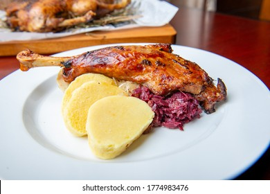 Roast duck, goose with dumplings and cabbage