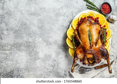 Roast duck with oranges and rosmarina. Gray background. Top view. Space for text