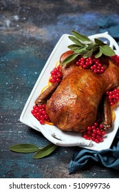 Roast duck with oranges, sage and berries, selective focus