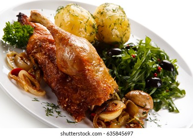 Roast duck with potatoes
