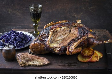 Roast Goose with Oragne Slices and Blue Kraut on old Metal Sheet