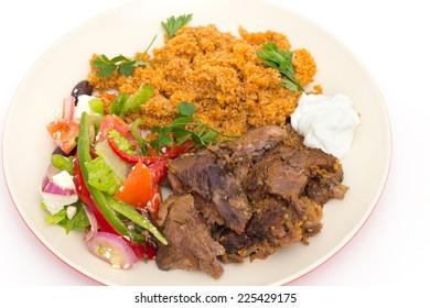 Roast lamb kuzu tandir, served with bulgur pilaf and a tossed Turkish salad, all mainstays of Ottoman cuisine