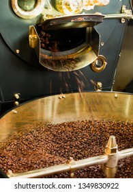 Roast machine, Frozen moment. The freshly roasted coffee beans from a coffee roaster being poured into the cooling cylinder.