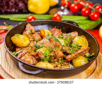 Roast meat with potato in a cast iron skillet