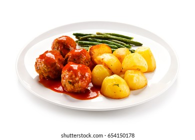 Roast meatballs with potatoes and green bean on white background