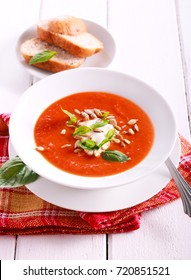 Roast pepper and tomato soup with seeds, ricotta and basil