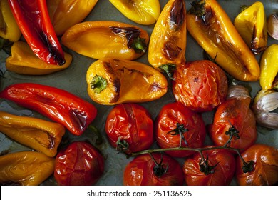 Roast peppers and tomatoes on baking tray
