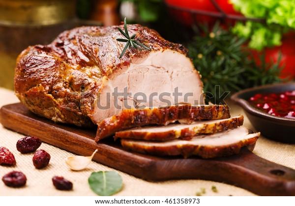 Roast pork with cranberry dip, basil, coriander and rosemary.