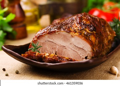 Roast pork with herbs and vegetables.