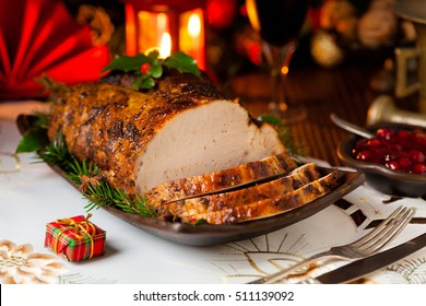 Roast pork loin with Christmas decoration. Front view.