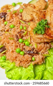 Roast pork and rice with vegetables and mushrooms