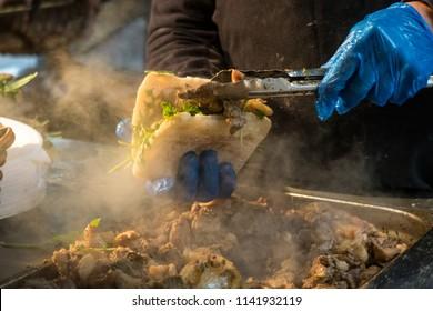 Roast Pork roll being prepared in London's Borough Market, UK