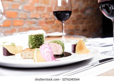 Roast pork tenderloin with crispy potato bread, marinated beetroots and green pepper sauce served in a restaurant
