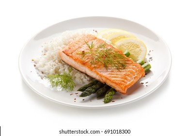 Roast salmon with rice on white background