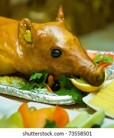 roast suckling pig on the decorated table in the restaurant