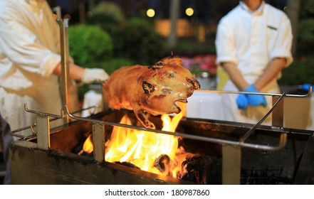 roast suckling pig in tradition celebration in chinese wildfire party in hong kong hotel
