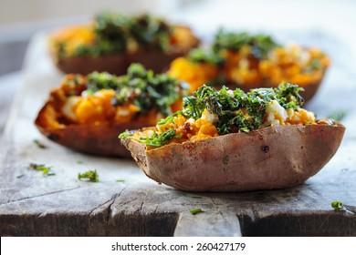 Roast sweet potato with feta cheese and crispy kale