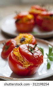 Roast tomatoes stuffed with rice, raisins and pine nuts