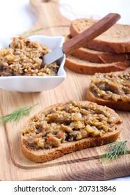 Roast vegetables: aubergine, pepper, tomato spread on bread