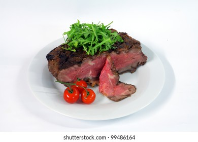 Roastbeef with gherkin and hot pepper on white background