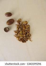 Roasted acorns on wooden board