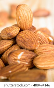 roasted almonds on wooden table