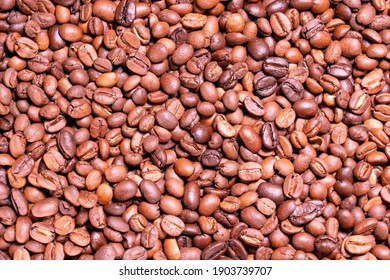 Roasted arabica coffee bean full frame backdrop background texture.