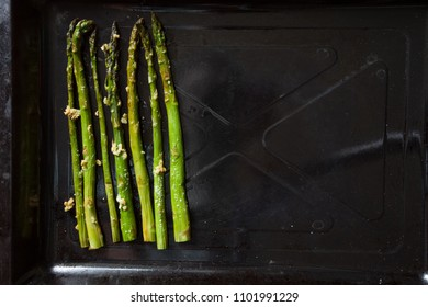 Roasted asparagus on pan, close-up. top view