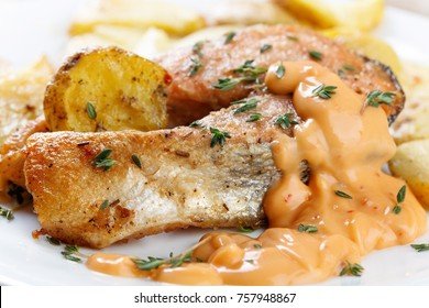 Roasted atlantic salmon with thyme and potatoes.