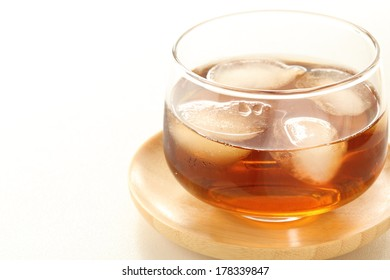Roasted barley tea with ice in glass  with copy space