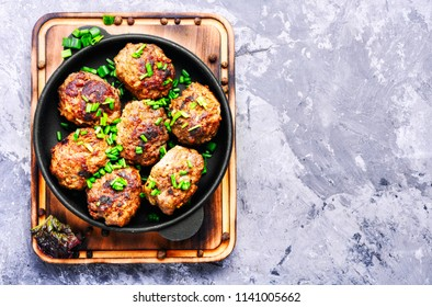 Roasted beef meatballs in cast-iron skillet.Delicious cutlet