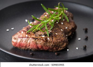 Roasted beef steak with rosemary, pepper and salt