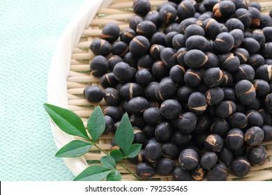Roasted black beans on bamboo colander