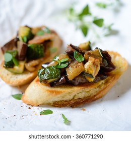 roasted bread slices with forest mushrooms and herbs