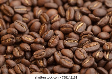 Roasted brown coffee beans as background