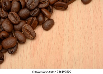 Roasted Brown Coffee Beans on Wooden Table banner template