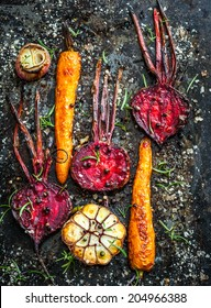 Roasted carrots and beetroot on a baking tray