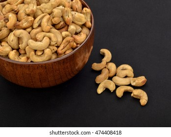 Roasted Cashew Nut In Wooden Bowl With Dark Background