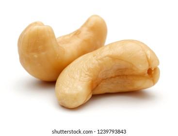 Roasted cashew nuts isolated on white background. Macro, studio shot